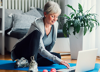 senior woman browsing fitness apps