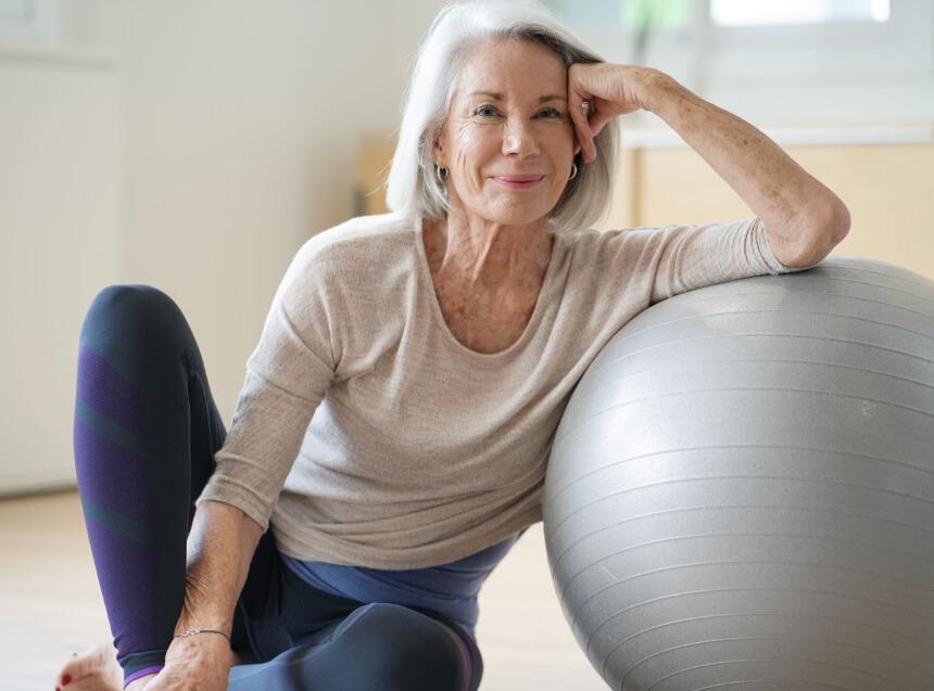 a senior woman with an exercise ball