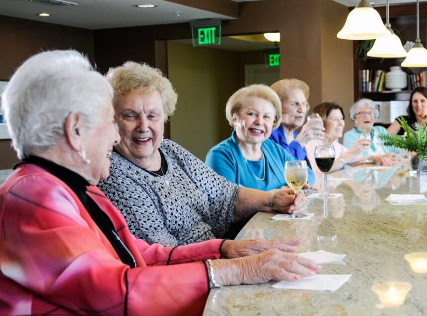 a group of senior women having fun at the bar